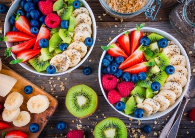 Breakfast bowl: granola with banana, kiwi, raspberry, strawberry, blueberry and chia seeds